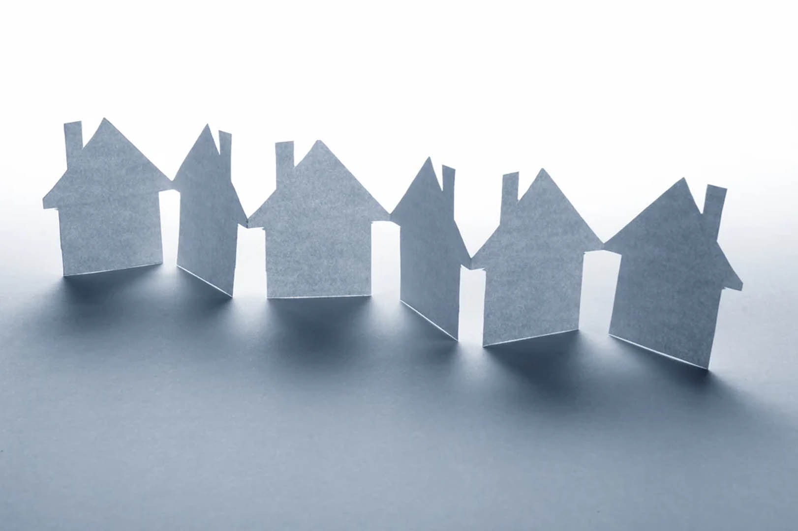 close-up-of-houses-cut-out-of-paper-on-white-background