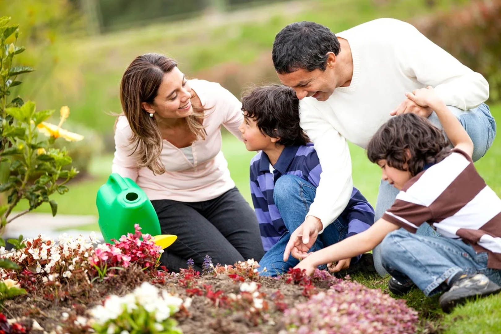 Happy-family-gardening-together-and-taking-care-of-nature