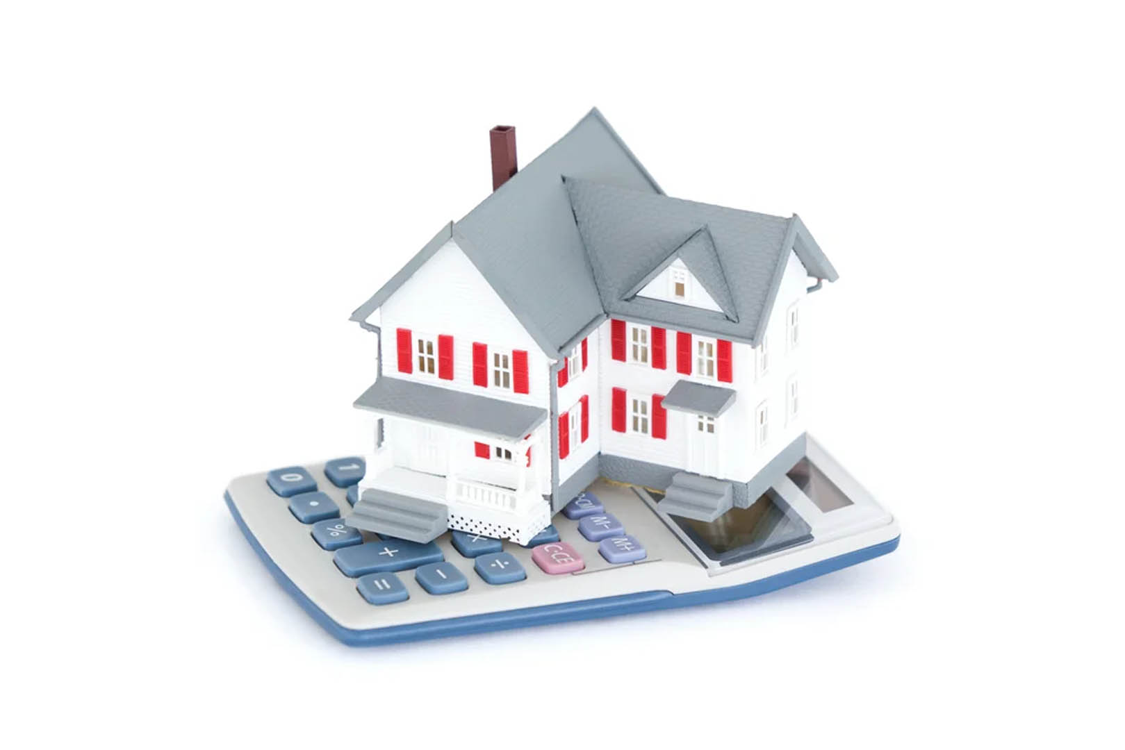 Miniature-house-with-a-calculator-against-a-white-background
